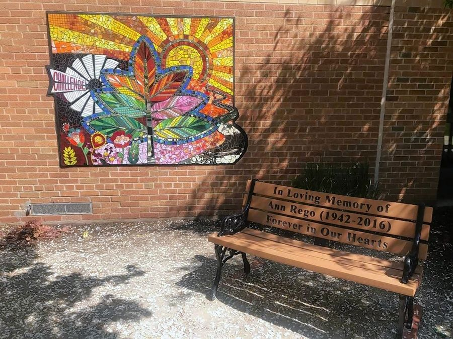 The new mural at J.B. Nelson Elementary School was created by students with design help from a professional artist. It was hung on an outside wall near a bench that was dedicated to Ann Rego, a beloved school secretary who passed away suddenly in 2016.