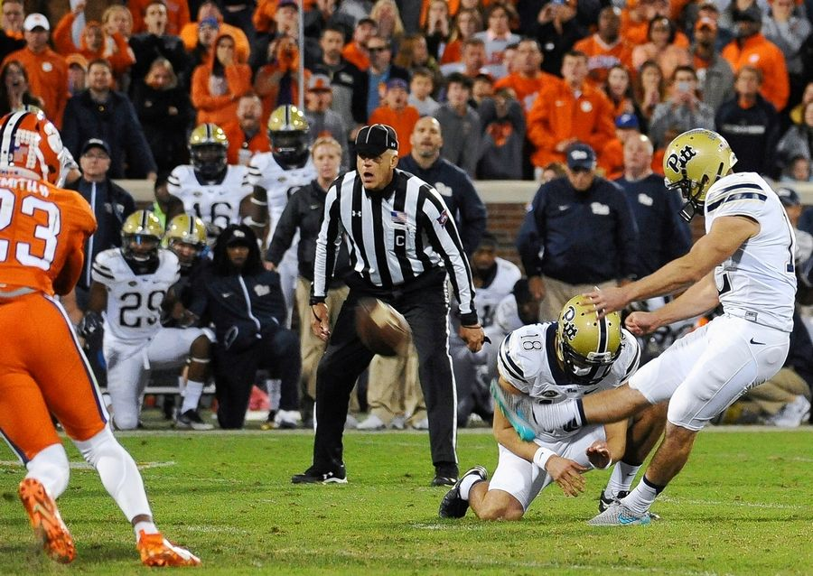 Pittsburgh kicker Chris Blewitt (12) kicks the game-winning field goal in an NCAA college football game against Clemson on Saturday, Nov. 12, 2016, in Clemson, The Bears waived the kicker Wednesday, reducing -- for now -- their battle to replace Cody Parkey to two men: Eddy Pineiro and Elliott Fry.