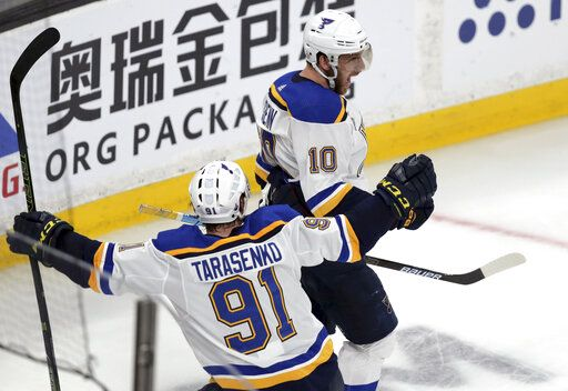 St. Louis Blues' Brayden Schenn (10) celebrates his goal against the Boston Bruins with Vladimir Tarasenko (91), of Russia, during the third period in Game 7 of the NHL hockey Stanley Cup Final, Wednesday, June 12, 2019, in Boston.