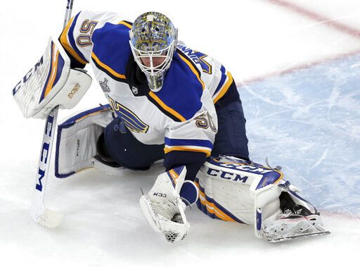 St. Louis Blues goaltender Jordan Binnington catches the puck during the third period in Game 7 of the NHL hockey Stanley Cup Final against the Boston Bruins, Wednesday, June 12, 2019, in Boston.