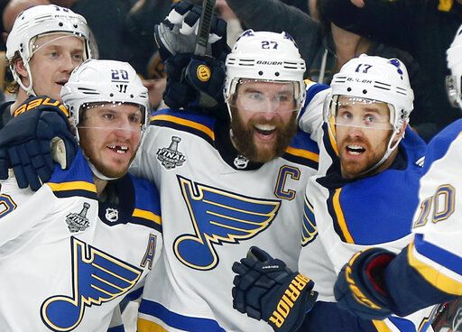 St. Louis Blues' Alex Pietrangelo, second from right, celebrates his goal with teammates Jay Bouwmeester, left rear, Alexander Steen, left, and Jaden Schwartz, right, during the first period in Game 7 of the NHL hockey Stanley Cup Final, Wednesday, June 12, 2019, in Boston.