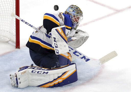 St. Louis Blues goaltender Jordan Binnington turns a shot away during the second period in Game 7 of the NHL hockey Stanley Cup Final against the Boston Bruins, Wednesday, June 12, 2019, in Boston.