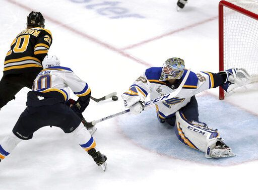 St. Louis Blues goaltender Jordan Binnington, right, stretches to make a save against Boston Bruins' Joakim Nordstrom (20), of Sweden, during the third period in Game 7 of the NHL hockey Stanley Cup Final, Wednesday, June 12, 2019, in Boston.