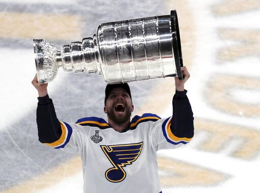 St. Louis Blues' David Perron carries the Stanley Cup after the Blues defeated the Boston Bruins in Game 7 of the NHL Stanley Cup Final, Wednesday, June 12, 2019, in Boston.