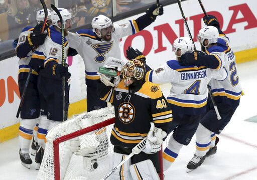 St. Louis Blues' Zach Sanford (12) celebrates his goal with teammates behind Boston Bruins goaltender Tuukka Rask (40), of Finland, during the third period in Game 7 of the NHL hockey Stanley Cup Final, Wednesday, June 12, 2019, in Boston.