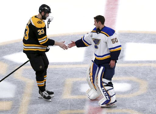 Boston Bruins' Zdeno Chara, left, of Slovakia, congratulates St. Louis Blues goaltender Jordan Binnington for the Blues' win over the Bruins in Game 7 of the NHL hockey Stanley Cup Final, Wednesday, June 12, 2019, in Boston.