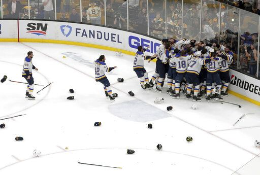 The St. Louis Blues celebrate their win over the Boston Bruins in Game 7 of the NHL hockey Stanley Cup Final, Wednesday, June 12, 2019, in Boston.