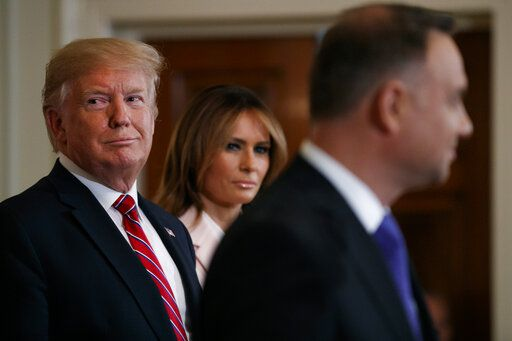 President Donald Trump and first lady Melania Trump attend a Polish-American reception with Polish President Andrzej Duda in the East Room of the White House, Wednesday June 12, 2019.