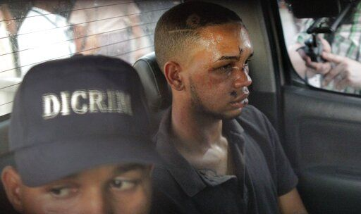 Eddy Vladimir Féliz Garcia, in custody in connection with the shooting of former Boston Red Sox slugger David Ortiz, is transferred by police to court in Santo Domingo, Dominican Republic, Tuesday, June 11, 2019. His lawyer, Deivi Solano, said Féliz Garcia had no idea who he'd picked up and what was about to happen, and that he expected Féliz Garcia would be charged as an accomplice to an attempted murder.