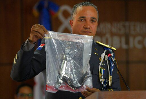 The director of the National Police, General Ney Aldrin Bautista Almonte shows the weapon that was used to shoot former Boston Red Sox slugger David Ortiz, during a press conference at the Attorney General's Office in Santo Domingo, Dominican Republic, Wednesday, June 12, 2019. Six suspects, including the alleged gunman, have been detained in the shooting, the Dominican Republic's chief prosecutor said Wednesday.