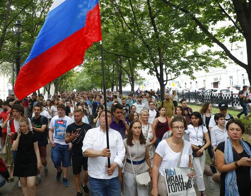 Supporters of Russian investigative journalist Ivan Golunov and other protesters gather to attend a march in Moscow, Russia, Wednesday, June 12, 2019.