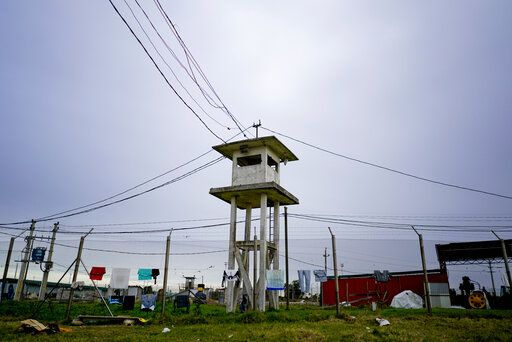 In this May 29, 2019 photo, an abandoned guard tower stands in the inner court area as clothes hang from a fence of the Punta de Rieles prison in Montevideo, Uruguay. Punta de Rieles is an exception not only in Uruguay but in Latin America where penitentiary systems are synonymous with inhumane treatment, inhospitable conditions and very high recidivism rates.