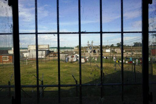 In this May 18, 2019 photo, the yards of the Punta de Rieles prison can be seen from a prison window, in Montevideo, Uruguay. Punta de Rieles is an exception not only in Uruguay but in Latin America where penitentiary systems are synonymous with inhumane treatment, inhospitable conditions and very high recidivism rates.