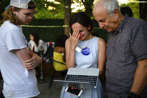 Yasmine Taeb, center, reacts as she watches the results of the vote come in, at an election night party at Zaaki Restaurant and Hookah Bar in Falls Church, Va., Tuesday, June 11. 2019. Saslaw, who did not face a primary challenger for 40 years, won the race. (Sarah L. Voisin/The Washington Post via AP)
