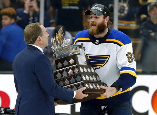 NHL Commissioner Gary Bettman presentes St. Louis Blues' Ryan O'Reilly with the Conn Smythe trophy after the Blues' win over the Boston Bruins in Game 7 of the NHL hockey Stanley Cup Final, Wednesday, June 12, 2019, in Boston.