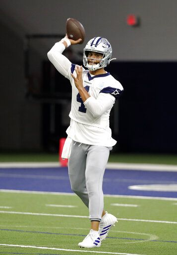 Dallas Cowboys quarterback Dak Prescott (4) throws a pass as he participates in drills at the team's NFL football training facility in Frisco, Texas, Wednesday, June 12, 2019. (AP Photo/Tony Gutierrez