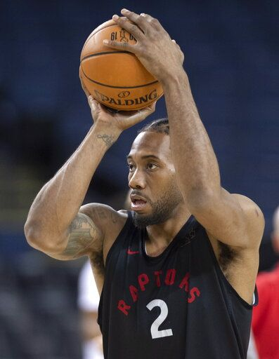 Toronto Raptors' Kawhi Leonard shoots during a team practice in Oakland, Calif., Wednesday, June 12, 2019. The Raptors are scheduled to play the Golden State Warriors in Game 6 of basketball's NBA Finals on Thursday. (Frank Gunn/The Canadian Press via AP)