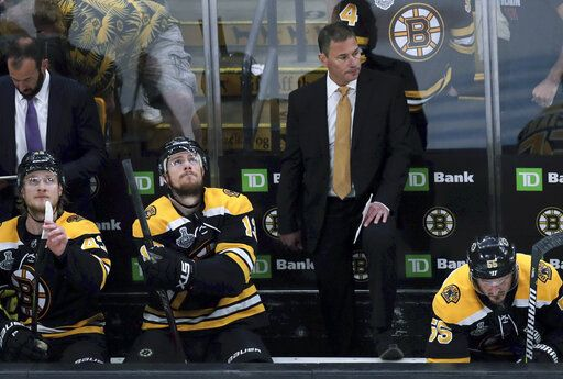 Boston Bruins head coach Bruce Cassidy watches from behind the bench during the first period in Game 7 of the NHL hockey Stanley Cup Final, Wednesday, June 12, 2019, in Boston.