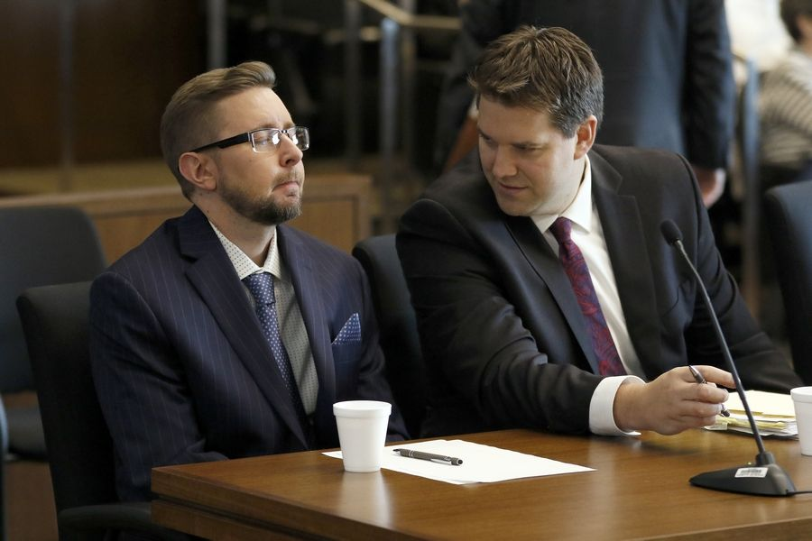 Kenneth Seplak, left, speaks to defense attorney Dan Hodgkinson on Wednesday during his trial in Lake County court in Waukegan. Seplak, 39, is on trial in the Dec. 23, 2016, murder of David Gorski, 30, of Libertyville.