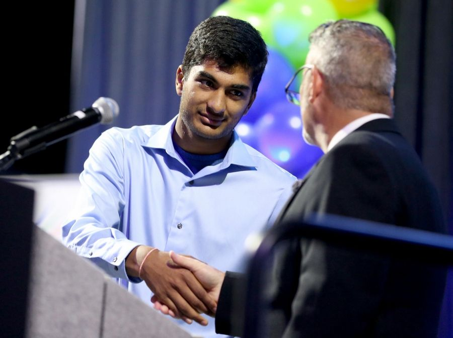 Rajat Mittal of Conant High School accepts a Heart & Soul Award during the Daily Herald Prep Sports Excellence Awards at Sears Centre Arena in Hoffman Estates on Thursday night.