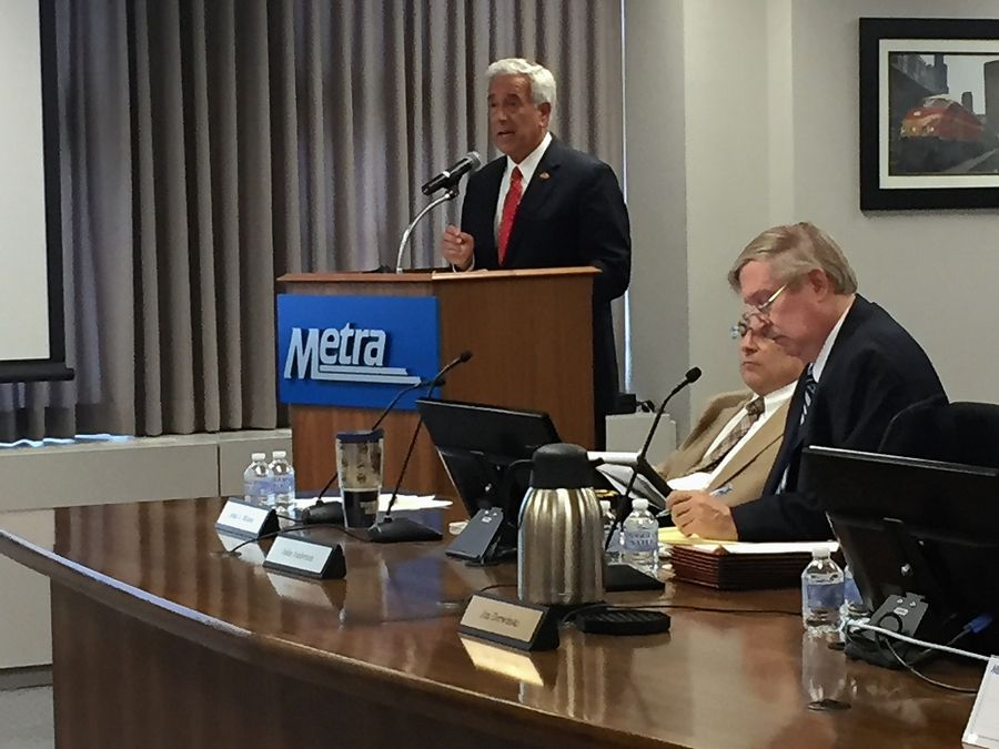 Kane County Chairman Chris Lauzen discusses concerns about extending the BSNF Line into Kendall County at a Wednesday Metra meeting.