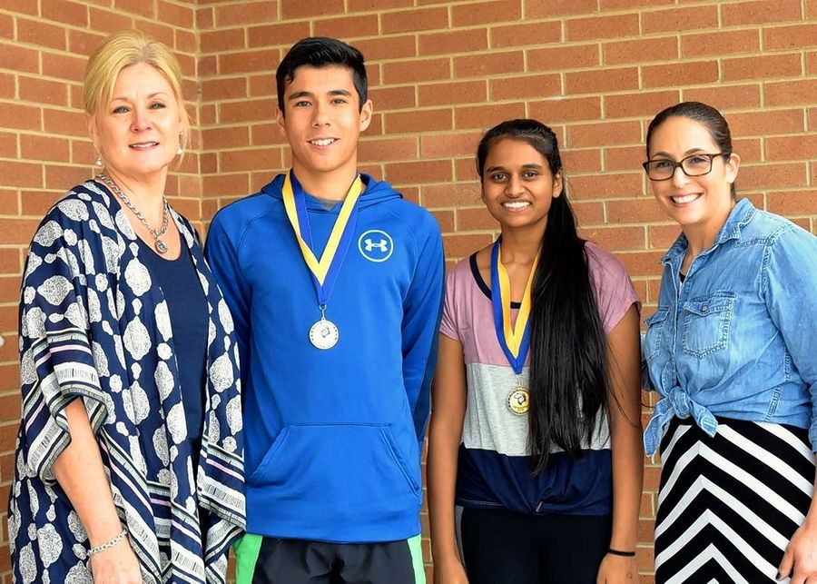 Superintendent Julie Schmidt, left, and Principal Jessica Barnes with Twin Groves Middle School Superintendent Award recipients Bhavya Vegesna and Matthew Bressler.