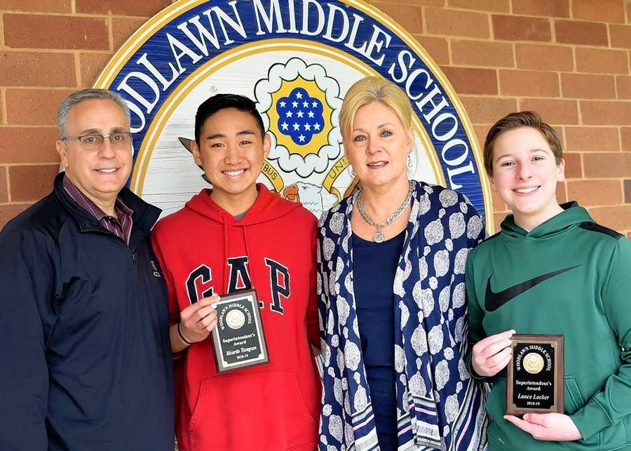 Principal Greg Grana and Superintendent Julie Schmidt with Woodlawn Middle School Superintendent Award recipients Ricky Tiongson and Lance Locker.