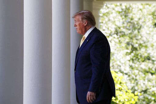 President Donald Trump walks through the Colonnade at the White House as he heads to the Rose Garden, Friday June 14, 2019, in Washington.