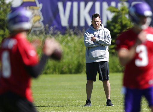 Minnesota Vikings assistant head coach and offensive advisor Gary Kubiak watches quarterbacks during drills at the team's NFL football training facility in Eagan, Minn., Thursday, June 13, 2019.