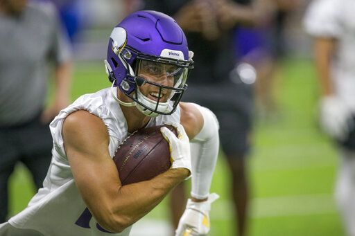 Minnesota Vikings wide receiver Adam Thielen runs after a catch during drills at the team's NFL football training facility in Eagan, Minn. Tuesday, June 11, 2019.
