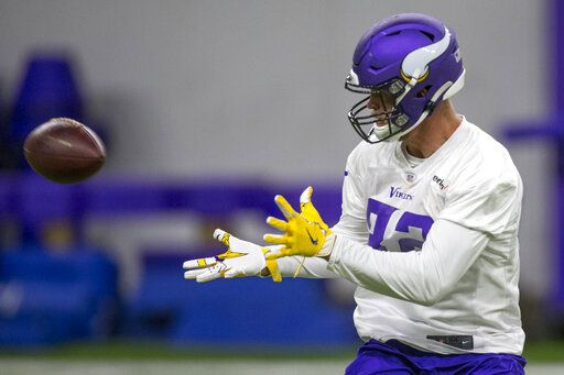 Minnesota Vikings tight end Kyle Rudolph makes a catch during drills at the team's NFL football training facility in Eagan, Minn. Tuesday, June 11, 2019.