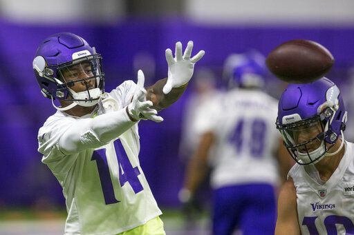 Minnesota Vikings wide receiver Stefon Diggs makes a catch during drills at the team's NFL football training facility in Eagan, Minn. Tuesday, June 11, 2019.