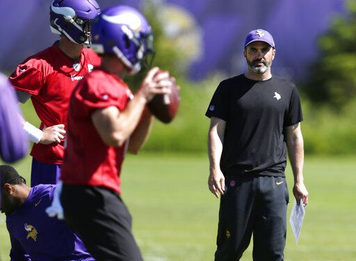Minnesota Vikings offensive coordinator Kevin Stefanski watches quarterbacks during drills at the team's NFL football training facility in Eagan, Minn., Thursday, June 13, 2019.