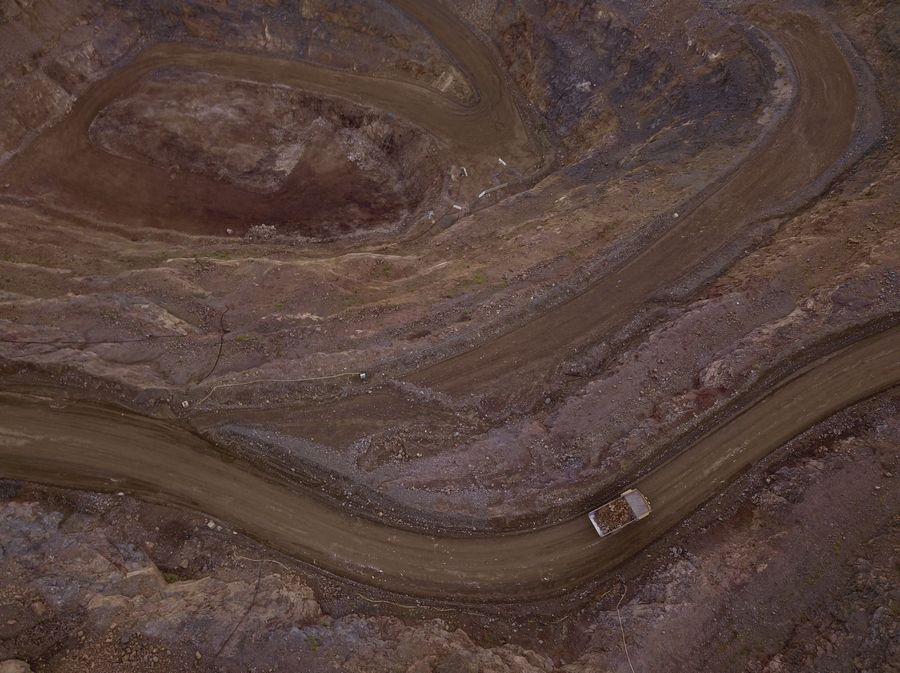 A dump truck hauls earth materials from the open pit at the Mountain Pass Mine on May 30, 2019 in Mountain Pass, Calif. Washington Post photo by Ricky Cariotti