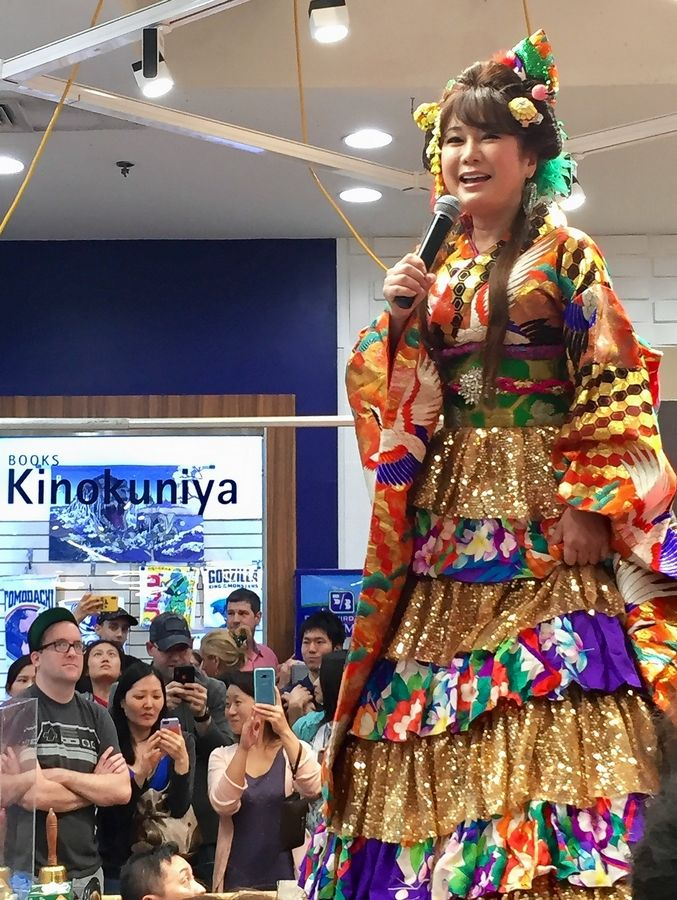 Japanese celebrity Ai Haruna performs at Mitsuwa Marketplace's renovation celebration in Arlington Heights Saturday.