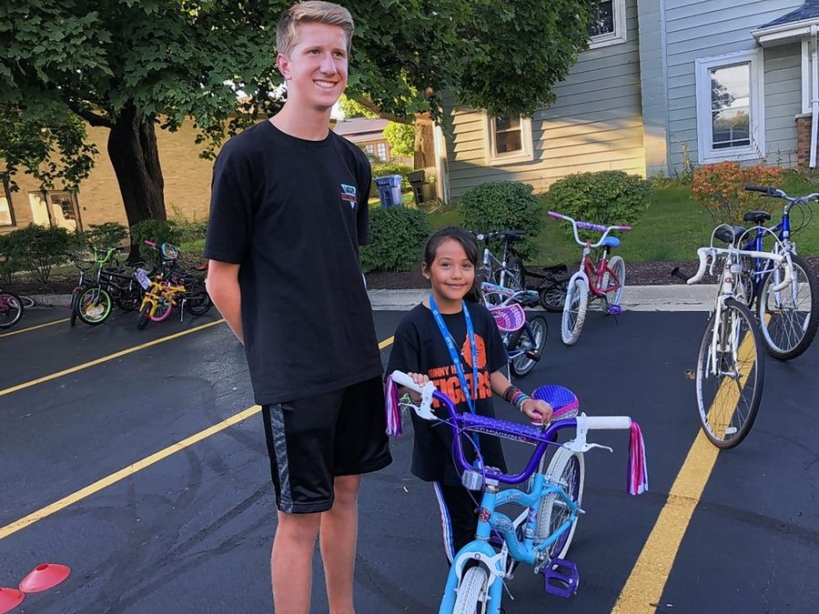 Last year, Jacobs High School graduate Justin Lorenz collected 80 donated bicycles for children of varying ages, like Aylin, 9, through his organization, Pedal Empowerment. He's now collecting bikes again for the clubs.