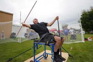 Tom Huene of Arlington Heights throws the javelin during the Great Lakes Games hosted by Great Lakes Adaptive Sports Association at Lake Forest High School Saturday.