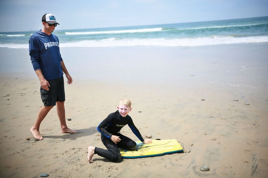 Chad Wells plays with his son Cooper at their beach house in Rosarito, Mexico, on June 9, 2019.