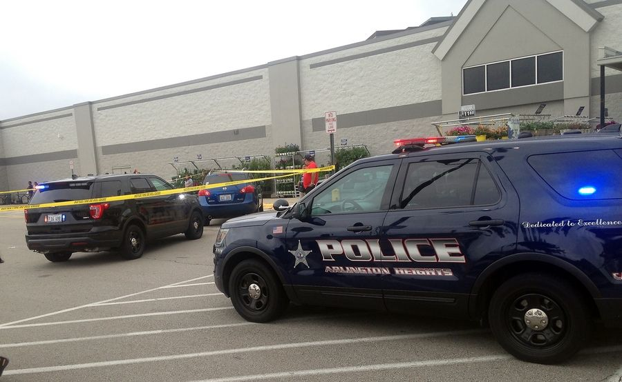 Rolling Meadows police, assisted by Arlington Heights police, investigate a shooting in a shopping center parking lot about 5:30 p.m. Saturday.