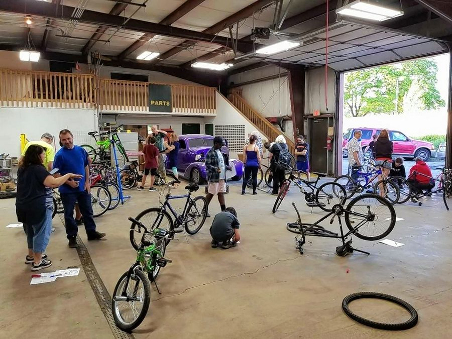 A group of 15 Round Lake area teens met at Collision Solution in Hainesville Monday evening to repair donated bikes, which they then got to keep.