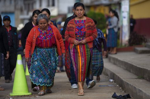 Indigenous women arrive at a polling station in Sumpango, Guatemala, Sunday, June 16, 2019. Guatemalans vote for their next president Sunday in elections plagued by widespread disillusion and distrust, and as thousands of their compatriots flee poverty and gang violence to seek a new life in the United States.