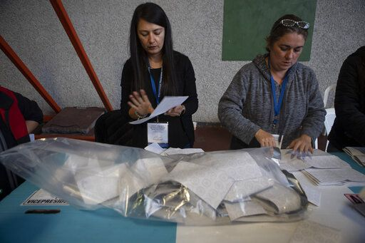 Election officials start counting votes after polls closed during general elections in Guatemala City, Sunday, June 16, 2019. Guatemalans are voting for their next president in elections plagued by widespread disillusion and distrust, and as thousands of their compatriots flee poverty and gang violence to seek a new life in the United States.