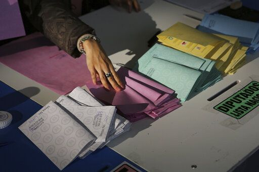 An electoral official keeps empty ballots organized during general elections in Guatemala City, Sunday, June 16, 2019. Guatemalans vote for their next president Sunday in elections plagued by widespread disillusion and distrust, and as thousands of their compatriots flee poverty and gang violence to seek a new life in the United States.