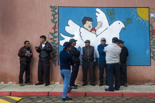 People line up to vote at a polling station in Sumpango, Guatemala, Sunday, June 16, 2019. Guatemalans are voting for their next president Sunday in elections plagued by widespread disillusion and distrust, and as thousands of their compatriots flee poverty and gang violence to seek a new life in the United States.