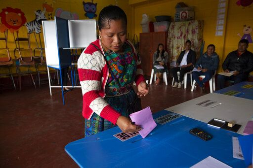 A indigenous woman casts her votes at a polling station in Sumpango, Guatemala, Sunday, June 16, 2019. Guatemalans vote for their next president Sunday in elections plagued by widespread disillusion and distrust, and as thousands of their compatriots flee poverty and gang violence to seek a new life in the United States.