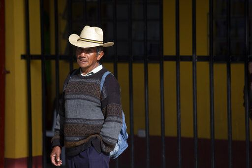 A man waits to casts his votes at a polling station in Sumpango, Guatemala, Sunday, June 16, 2019. Guatemalans are voting for their next president Sunday in elections plagued by widespread disillusion and distrust, and as thousands of their compatriots flee poverty and gang violence to seek a new life in the United States.