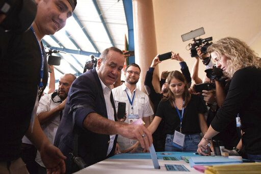 Alejandro Giammattei, presidential candidate of the Vamos party, casts his vote during general elections in Guatemala City, Sunday, June 16, 2019. Guatemalans vote for their next president Sunday in elections plagued by widespread disillusion and distrust, and as thousands of their compatriots flee poverty and gang violence to seek a new life in the United States.