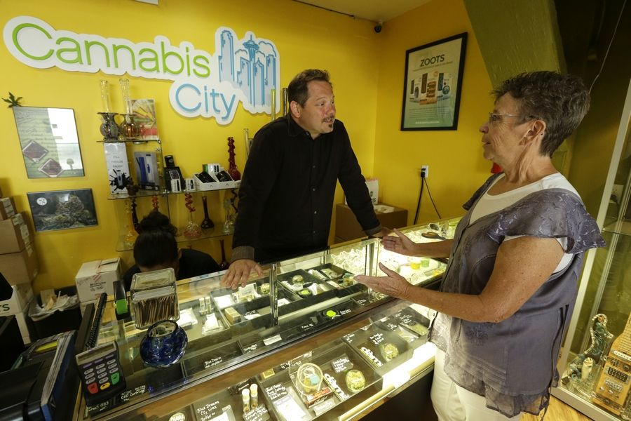 Municipalities across the region are starting to discuss whether to allow recreational marijuana retail shops, like the Cannabis City store shown in Seattle, to open within their boundaries under a new state law that permits adult use beginning Jan. 1.