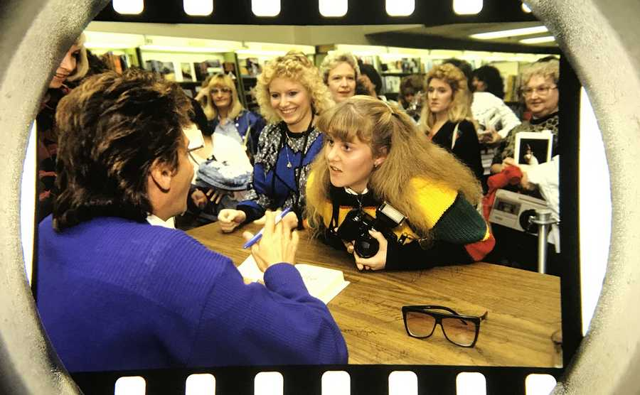 The Daily Herald Archives, Assignment 90,057, Vince Pierri photo: A star struck Barry Manilow fan waits for her copy of his signed book in Chicago in November of 1987.