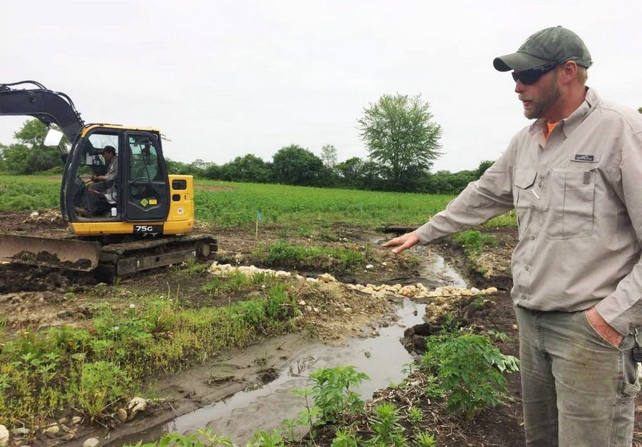 Damon Cederberg, open space field coordinator for Libertyville Township, explains how a 44-acre farm field is being restored to a natural state. The effort include planting 10,000 native grass plugs.